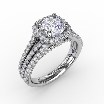 Cushion-Shaped Diamond Halo Engagement Ring With Triple-Row Diamond Band