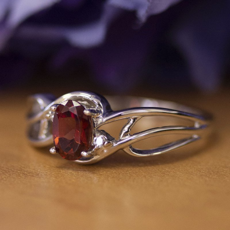 Color Merchants 10k White Gold Oval Garnet And Diamond Curve Ring