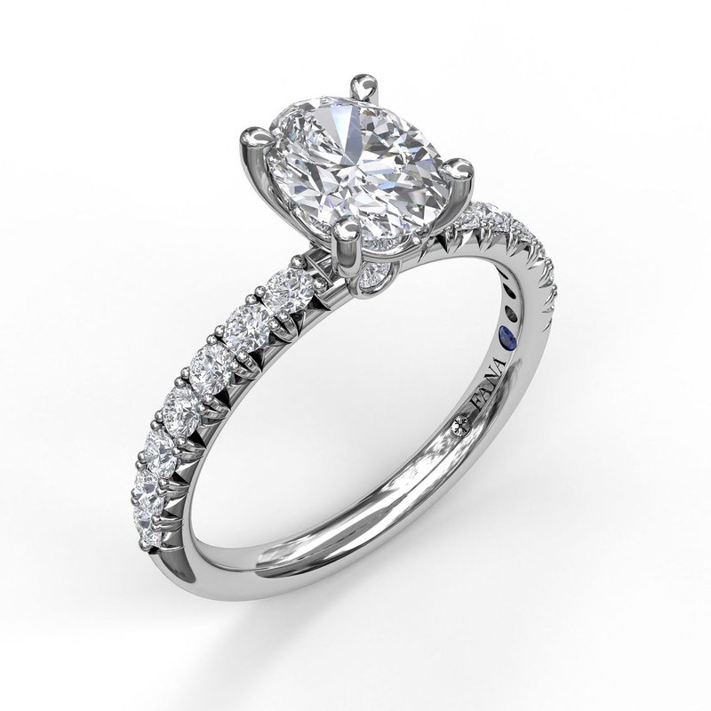 Oval Cut Solitaire With French Cut Pave