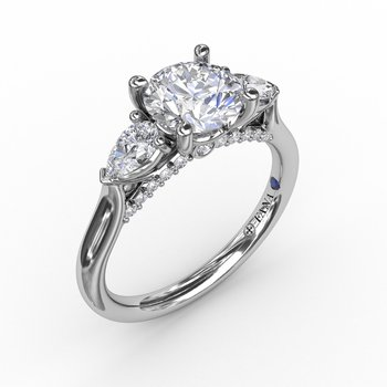 Classic Three-Stone Diamond Engagement Ring With Pear-Shape Side Diamonds