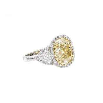 FANCY YELLOW CUSHION CUT DIAMOND