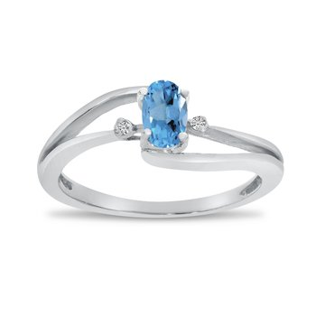 14k White Gold Oval Blue Topaz And Diamond Wave Ring