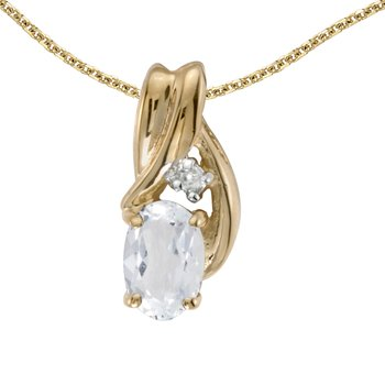 14k Yellow Gold Oval White Topaz And Diamond Pendant