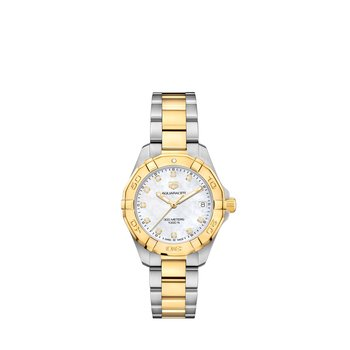 Lady Aquaracer In Stainless Steel And Yellow Gold Plate. The 32 mm Quartz Watch Has A Plated Rotating Bezel, Mother Of Pearl Dial With Diamond Hour Markers And Steel Bracelet With Gold Plated Center Link And Wet-Suit Extension. Model WBD1322.