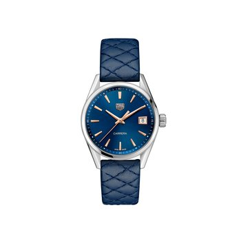 Ladies Carrera Quartz Watch. The 36 mm Steel Watch Has A Blue Dial With Rose Gold Applied Hour Markers And A Blue Calf Skin Quilted Strap With Folding Clasp. Model WBK1312.