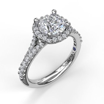 Classic Halo With A Twist Engagement Ring