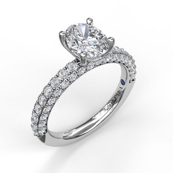 Diamond-Encrusted Engagement Ring with Oval Center Stone