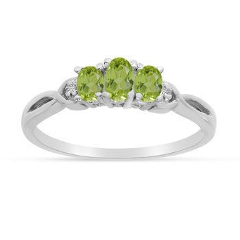 10k White Gold Oval Peridot And Diamond Three Stone Ring