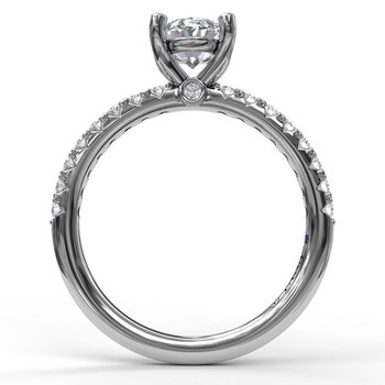 Classic Single Row Engagement ring with an Oval Center Diamond.