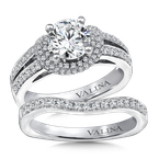 Valina Bridals Mounting with side stones .59 ct. tw., 1 1/4 ct. round center.