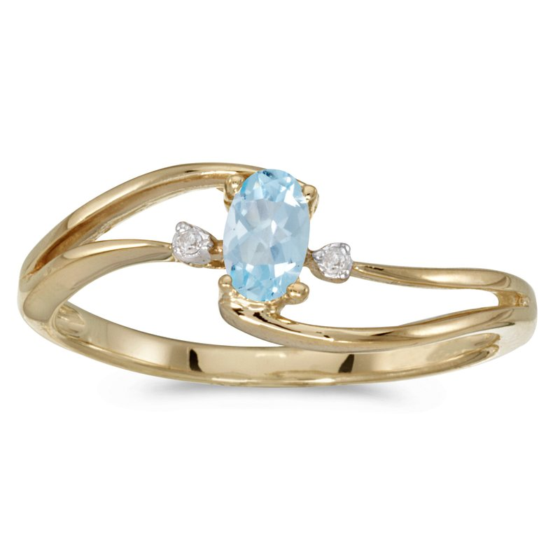 Color Merchants 14k Yellow Gold Oval Aquamarine And Diamond Wave Ring