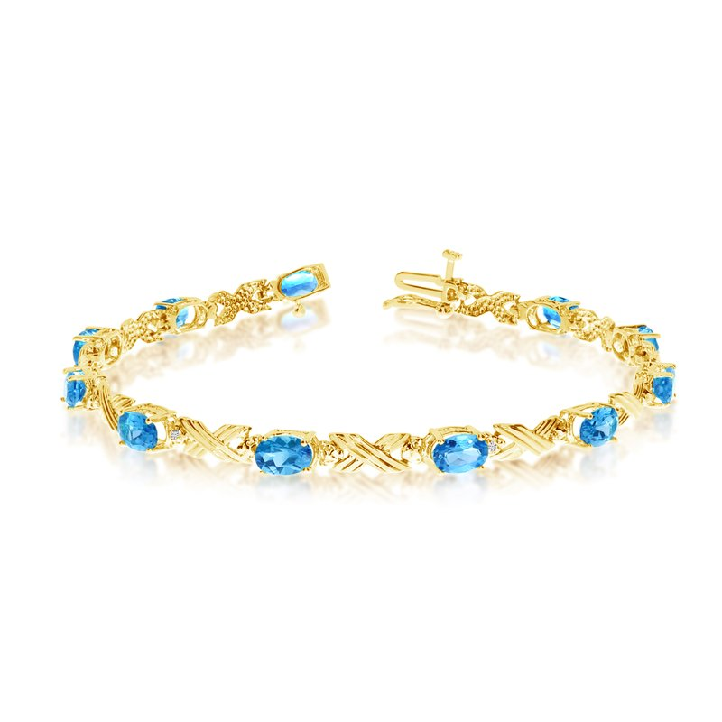 Color Merchants 10K Yellow Gold Oval Blue Topaz and Diamond Bracelet