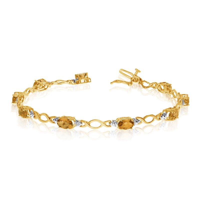 Color Merchants 10K Yellow Gold Oval Citrine and Diamond Bracelet