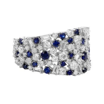 diamonds in  14K gold ring with different shaped stones. Baguettes mixed with rounds and Sapphires. Dia T.W 2.58CT