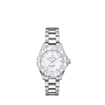 Lady Aquaracer In Stainless Steel. The 32 mm Quartz Watch Has A  Rotating Bezel, White Mother Of Pearl Dial With Diamond Hour Markers And Steel Bracelet With A Wet-Suit Extension. Model WBD1314.