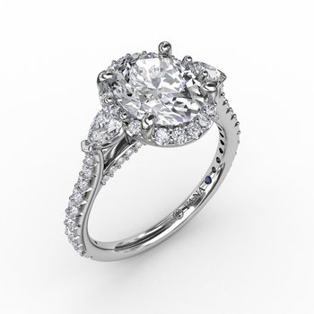 Oval Diamond Halo Engagement Ring With Pear-Shape Diamond Side Stones