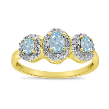 10k Yellow Gold Oval Aquamarine And Diamond Three Stone Ring