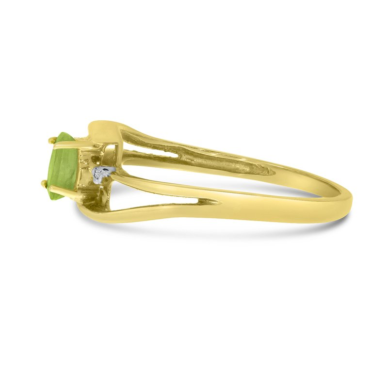 Color Merchants 14k Yellow Gold Oval Peridot And Diamond Wave Ring