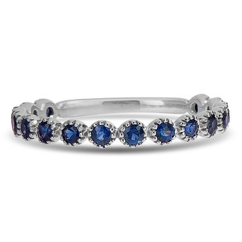14K WG and blue sapphire ring in bezel setting