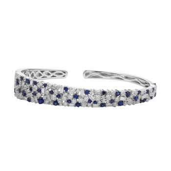 sapphire and diamond cuff crafted in 14k gold.Combines an array of mixed shaped baguettes and round brilliants.T.W in diamonds 3.43