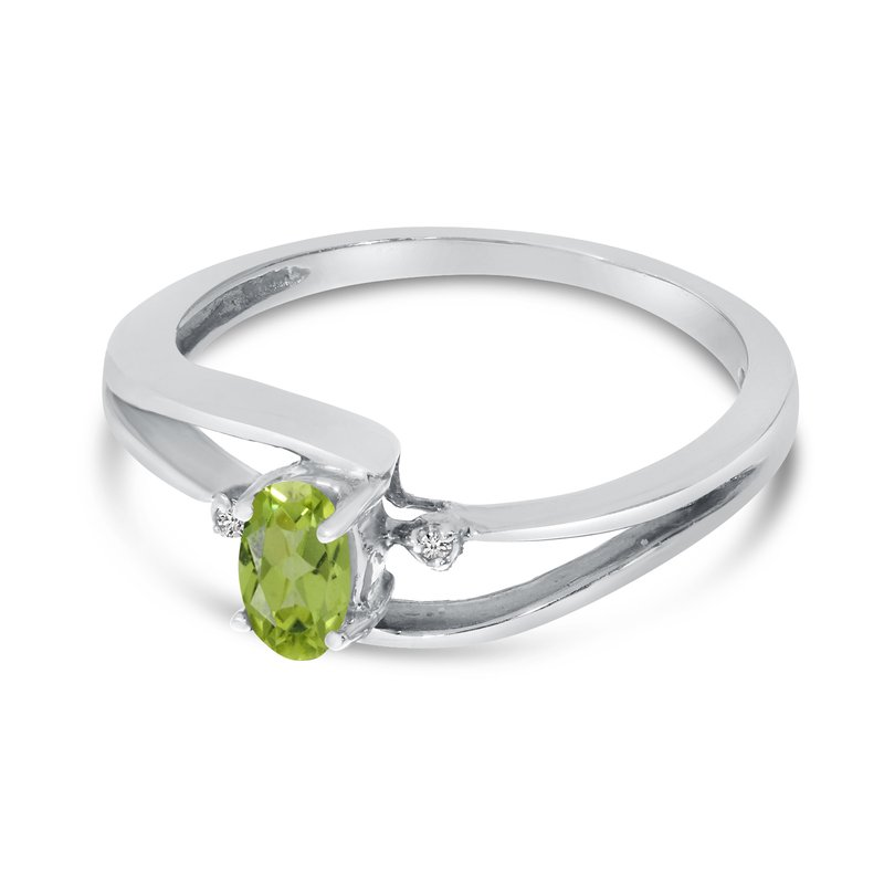 Color Merchants 10k White Gold Oval Peridot And Diamond Wave Ring