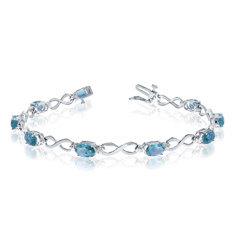 Color Merchants 14K White Gold Oval Blue Topaz and Diamond Bracelet