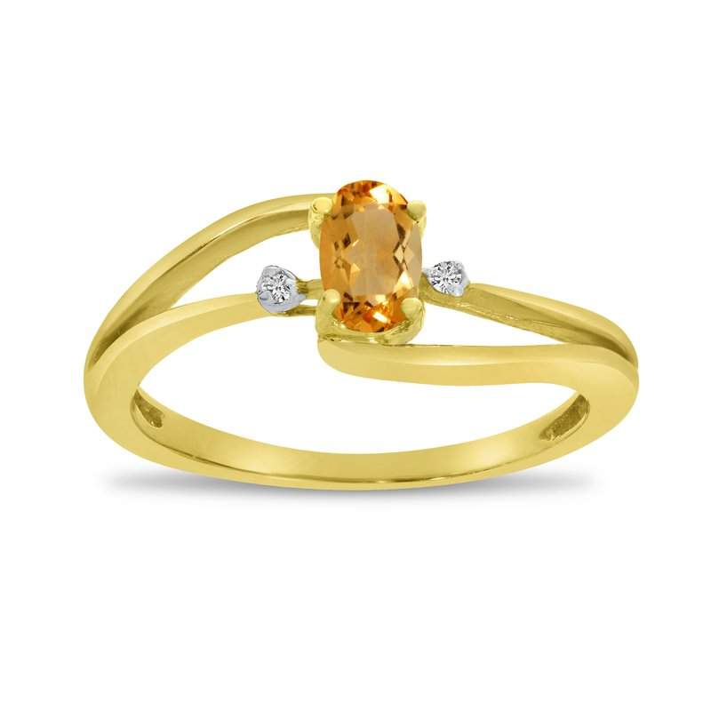 Color Merchants 14k Yellow Gold Oval Citrine And Diamond Wave Ring