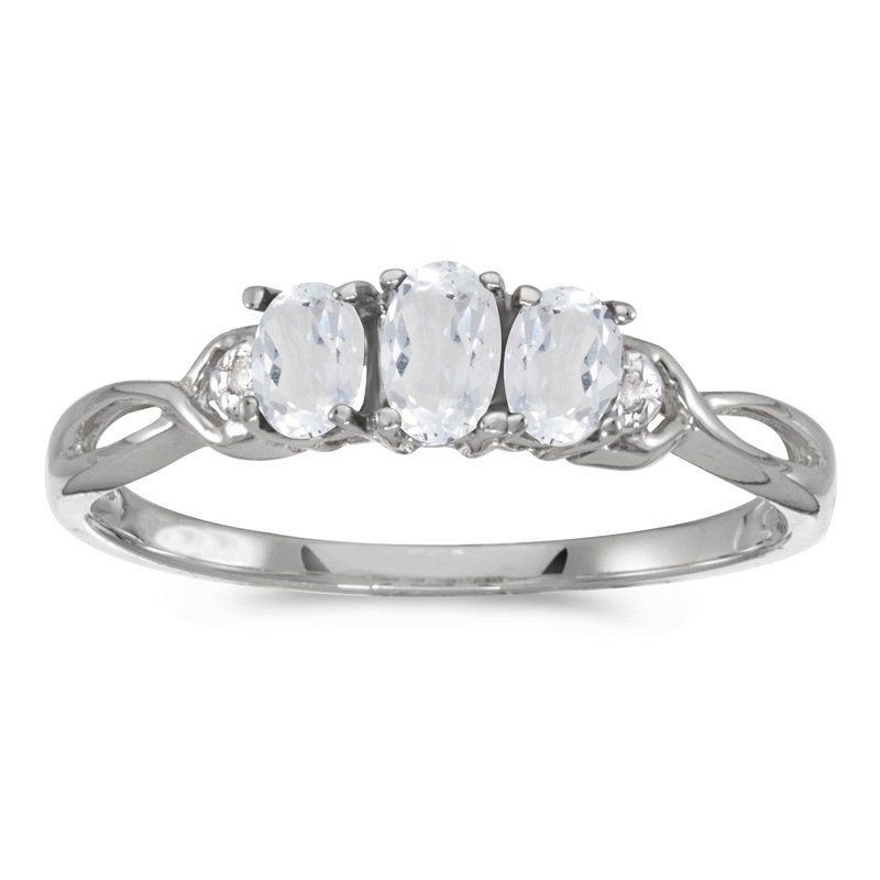 Color Merchants 10k White Gold Oval White Topaz And Diamond Three Stone Ring