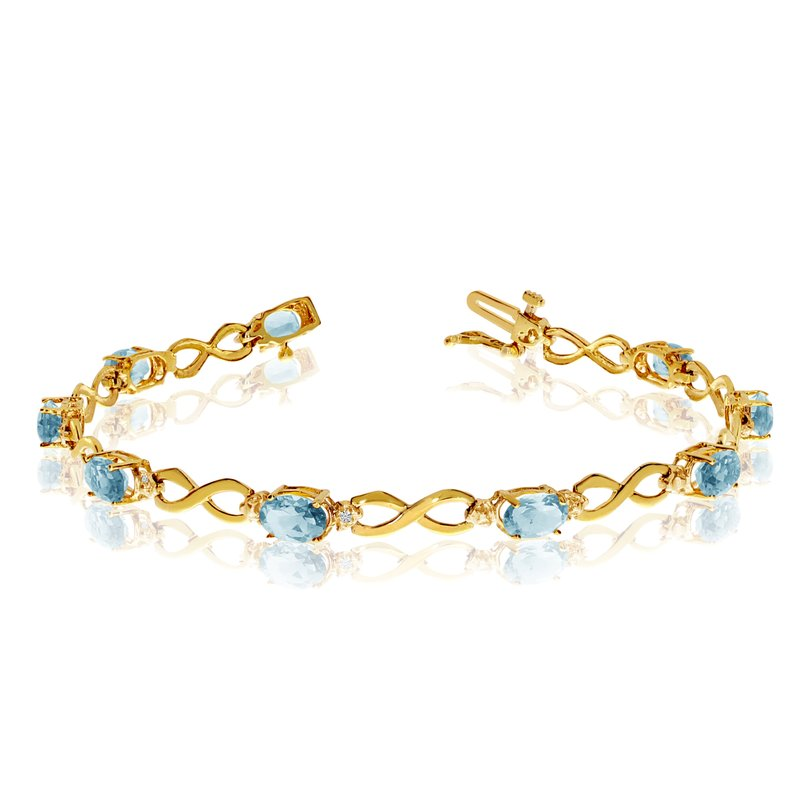 Color Merchants 10K Yellow Gold Oval Aquamarine and Diamond Bracelet