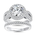 Caro74 Round halo mounting with side stones 1.09 ct. tw., 2 1/2 ct. round center.