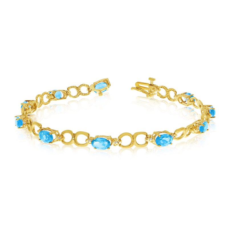 Color Merchants 14K Yellow Gold Oval Blue Topaz and Diamond Bracelet