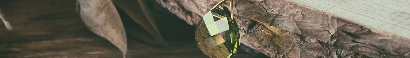 Gifts Banner - image of green faceted gemstone
